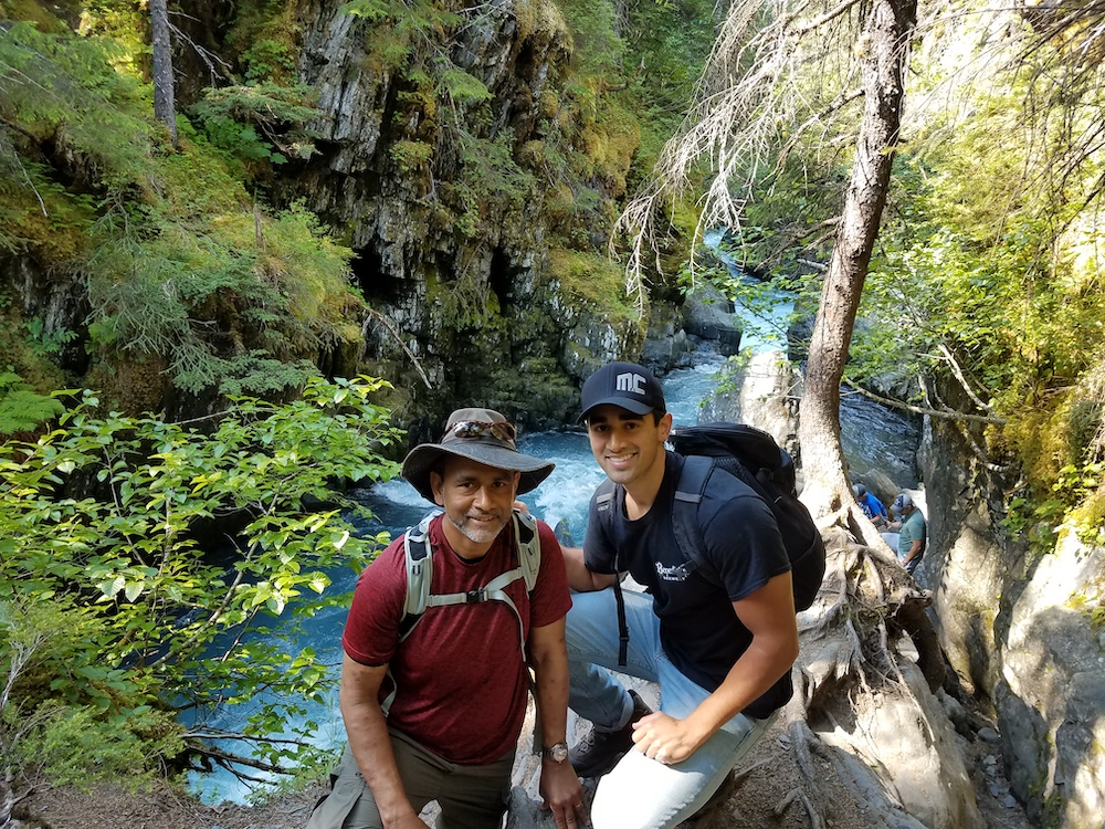 Father and son hiking in Alaska.